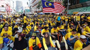 Protesters occupy a street in downtown Kuala Lumpur in November to demand electoral reform and Najib Razak's resignation.