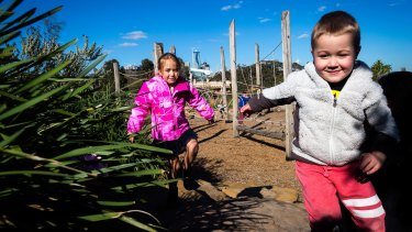 Anna, 6, and Xavier, 4, at the Royal Park Nature Play playground.