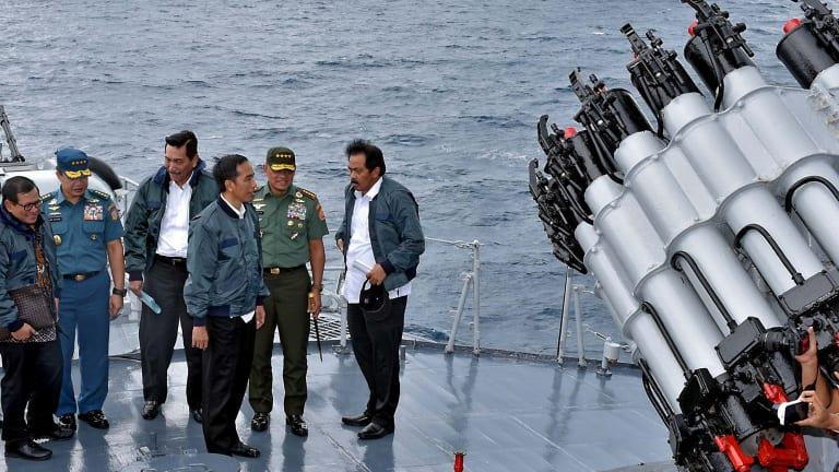 Indonesian President Joko Widodo, third from right, on the deck of an Indonesian navy warship in the waters of the Natuna Islands.