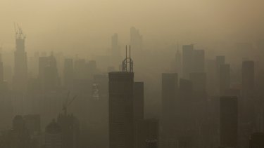 Smog hangs in the air around buildings in the Luohu district of Shenzhen, China.