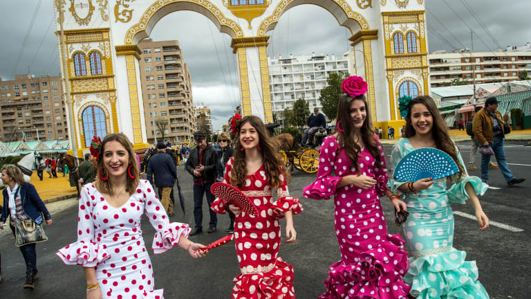 Young women in traditional dress in Seville. Spain is notorious for theft.