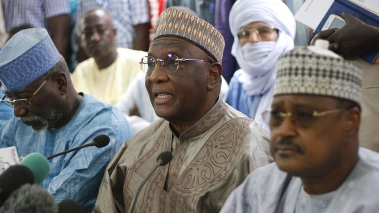 Niger opposition party leader Amadou Boubacar Cisse (centre) at a media briefing before elections results were announced on Tuesday.