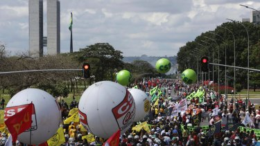 Demonstrators march during a general strike in Brasilia, on Friday.