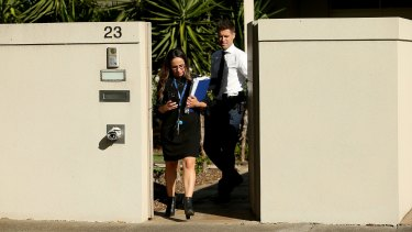 Police leave the Ristevski family home on Tuesday.