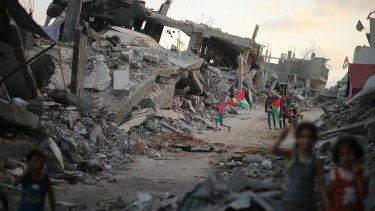 In September last year, Palestinian children play near the ruins of their houses  in the devastated area of the east of Gaza City, destroyed during the seven-week Israeli offensive last year.