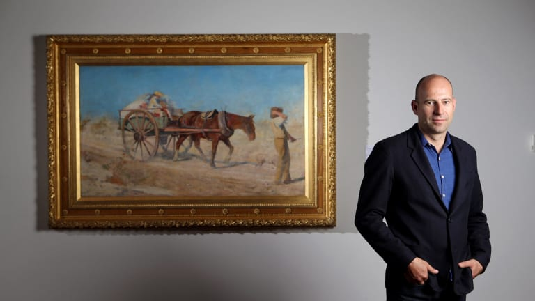 NGV head of conservation Michael Varcoe-Cocks with the restored McCubbin work, The North Wind.