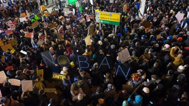 Protesters assemble at John F. Kennedy International Airport in New York after  two Iraqi refugees were detained while trying to enter the country.