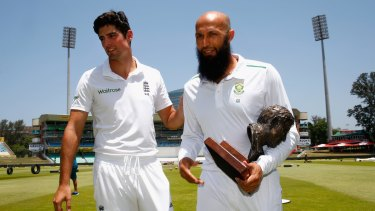Cook and South Africa captain Hashim Amla after posing for photographs with the Basil D'Oliveira trophy at Kingsmead on Thursday.