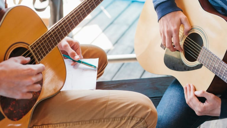 A hobby such as playing the guitar can form the basis of a 'side hustle'.