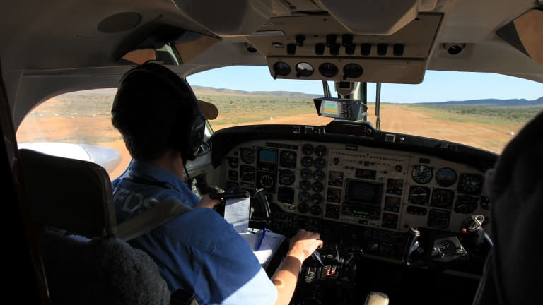 A Royal Flying Doctor Service doctor takes off from Yunta  (pop. 40 in the town)  after a day of delivering services in the small town just across the NSW border from Broken Hill.