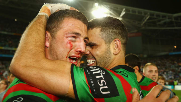Back together: Sam Burgess and Greg Inglis celebrate winning the 2014 NRL grand final. Burgess has returned to Redfern after a season in rugby.