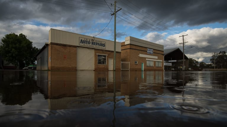 A flooded Forbes street as more rain begins to fall.