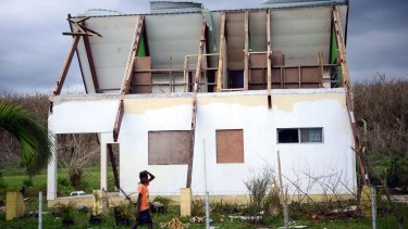 A house damaged by Cyclone Pam on the Vanuatu island of Tanna.