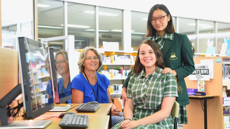 Teacher Rachel Lilley with students Elizabeth Son and Anna Costa Lopes. Ms Lilley has developed a course to enhance students' IT and communications skills.