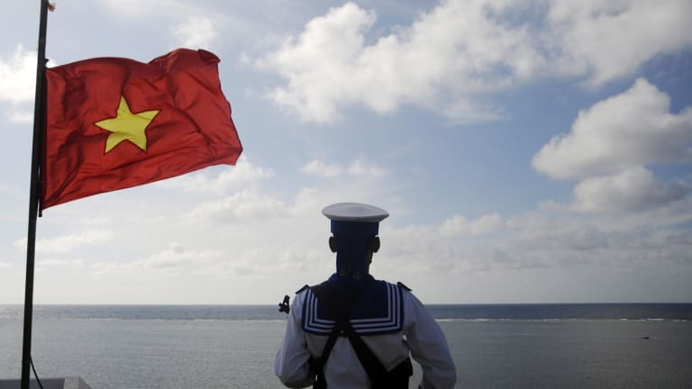 A Vietnamese naval soldier stands quard at Thuyen Chai island in the Spratly archipelago in 2013.