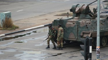 A military tank is seen with armed soldiers on the road leading to President Robert Mugabe's office in Harare, on Wednesday.