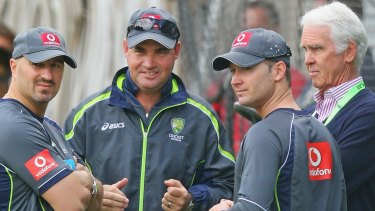 Michael Clarke talks to Australian chairman of selectors John Inverarity (right), Australian coach Mickey Arthur (centre) and physiotherapist Alex Kountouris (left).
