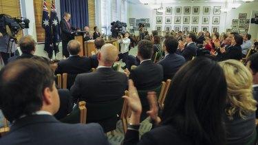 Labor MPs and senators applaud Opposition Leader Bill Shorten.