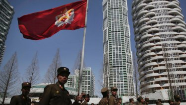 North Korean soldiers carry the Korean People's Army flag  in Pyongyang.