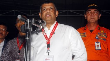 """""""The weather in south-east Asia is bad at the moment"""": AirAsia CEO Tony Fernandes (centre)."""