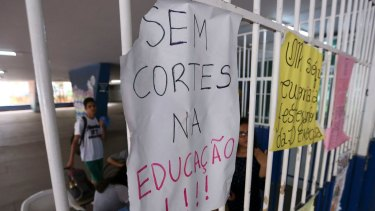 "Students occupy the Elefante Branco high school in Brasilia, Brazil. The sign says ""No cuts to education""."