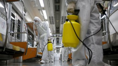 A subway train is disinfected in Goyang, South Korea, on Wednesday.