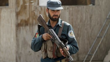 An Afghan policemanat his checkpoint in Kandahar, Afghanistan, in January.