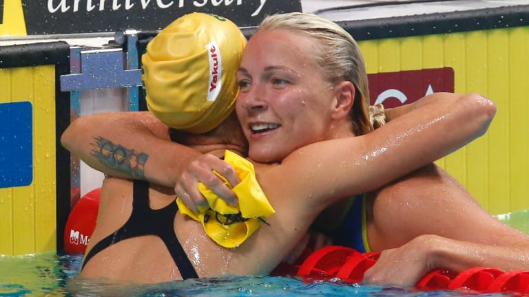 Changing of the guard: Sarah Sjostrom hugs Australia's Emma McKeon after winning gold in the women's 100-metre butterfly final in Budapest.