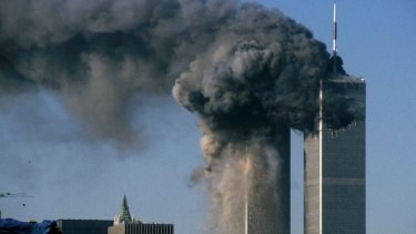 Smoke rises and debris falls from the World Trade Center south tower on September 11.