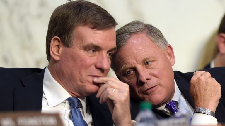 Senate Intelligence Committee Chairman Senator Richard Burr, right, talks with Vice Chairman Senator. Mark Warner, left, during the hearing on Thursday.