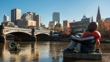 Artwork called Inflatable Refugee, pictured on the Yarra River on Saturday, is touring the globe to highlight the plight of the world's 65 million displaced people.