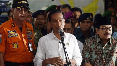 """""""We also feel the loss from this tragedy"""": Indonesian President Joko Widodo (centre)."""
