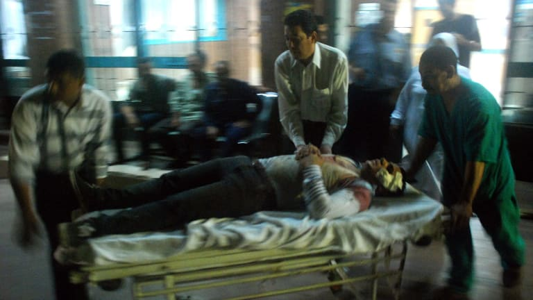 A wounded man arrives at a hospital after a bomb exploded in Cairo.