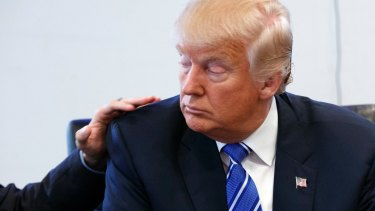 Art Del Cueto, a vice president for the National Border Patrol Council, puts his hand on Donald Trump's shoulder during a security meeting at Trump Tower on Friday.