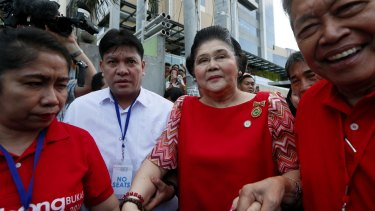 Former First Lady and now Congresswoman Imelda Marcos, centre, arrives to lend support to her son vice-presidential candidate Bongbong Marcos.