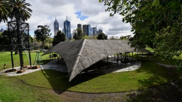 Indian architect Bijoy Jain's MPavilion sits against a backdrop of the city skyline in Melbourne's Queen Victoria Gardens