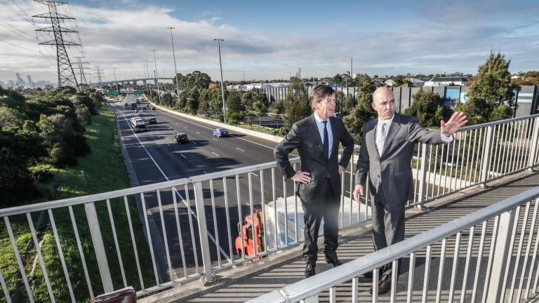 Roads Minister Luke Donnellan (left) on Monday with Western Distributor Authority chief executive Peter Sammut. They in Yarraville above the West Gate Freeway.