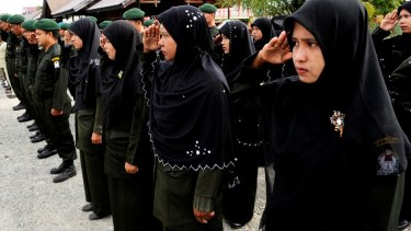 Sharia Police on parade at the beginning of their shift in West Aceh.