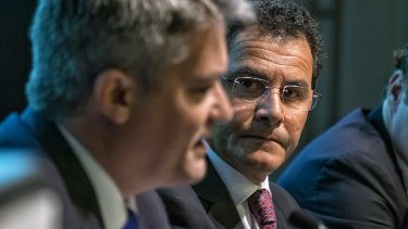Price cap of $2 a share for retail investors: Mathias Cormann and Medibank managing director George Savvides at the Melbourne Convention and Exhibition Centre.
