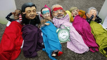 Oxfam activists wear masks of from left, Barack Obama, Xi Jinping, Francois Hollande, India's Prime Minister Narendra Modi, German Chancellor Angela Merkel and Australia's Prime Minister Malcolm Turnbull during the COP21 Conference in Paris this month. The first three are also among the world's top travellers.