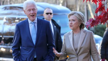 Hillary Clinton and her husband former president Bill Clinton talk after voting in Chappaqua, New York, on election day.