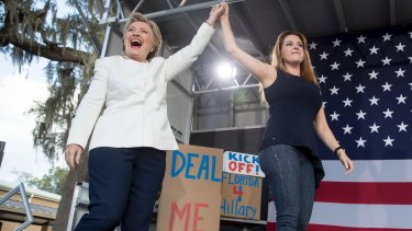 Democratic presidential candidate Hillary Clinton takes the stage with former Miss Universe Alicia Machado, in Dade City, Florida.