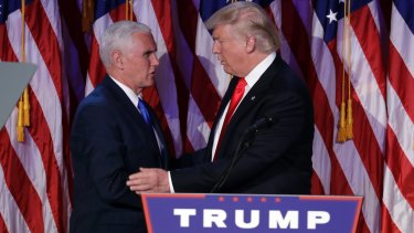 President-elect Donald Trump, right, shakes hands with Vice-President-elect Mike Pence during his victory party.