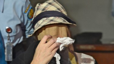 Corby, with her face covered by a veil and carrying a tissue to wipe away her tears, leaves Bali's Kerobokan jail in February 2014 after being granted parole.