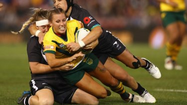 Tough night at the office: Samantha Bremner of the Jillaroos is tackled.