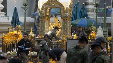 Police investigate the scene around the Erawan Shrine on Tuesday.
