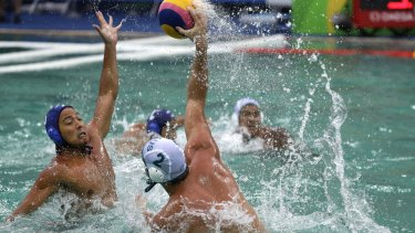 Australia's Richie Campbell, holding the ball, says his eyes were stinging.