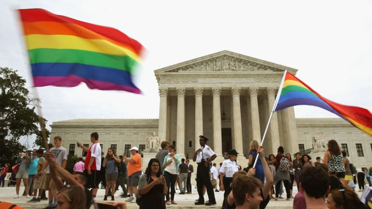 People celebrate in front of the US Supreme Court after the ruling in favor of same-sex marriage June 26, 2015 in Washington, DC. The high court ruled that same-sex couples have the right to marry in all 50 states.