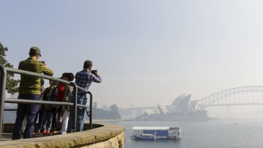 Thick smoke blankets Sydney Harbour.