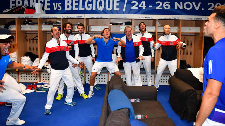 French captain Yannick Noah (left) and his team celebrate their victory.
